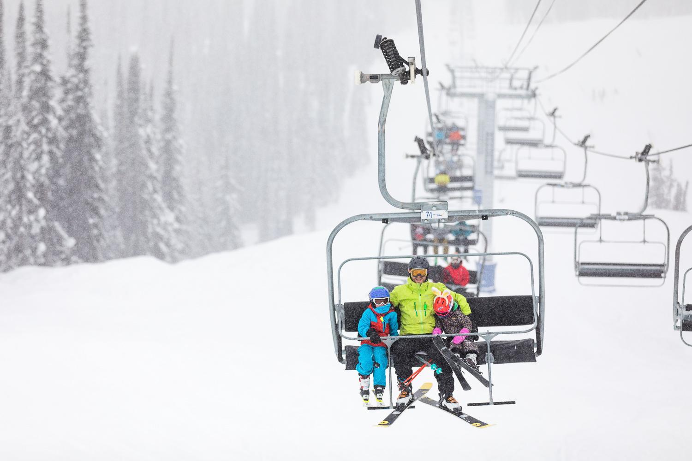 Family on chair lift Revelstoke Mountain Resort