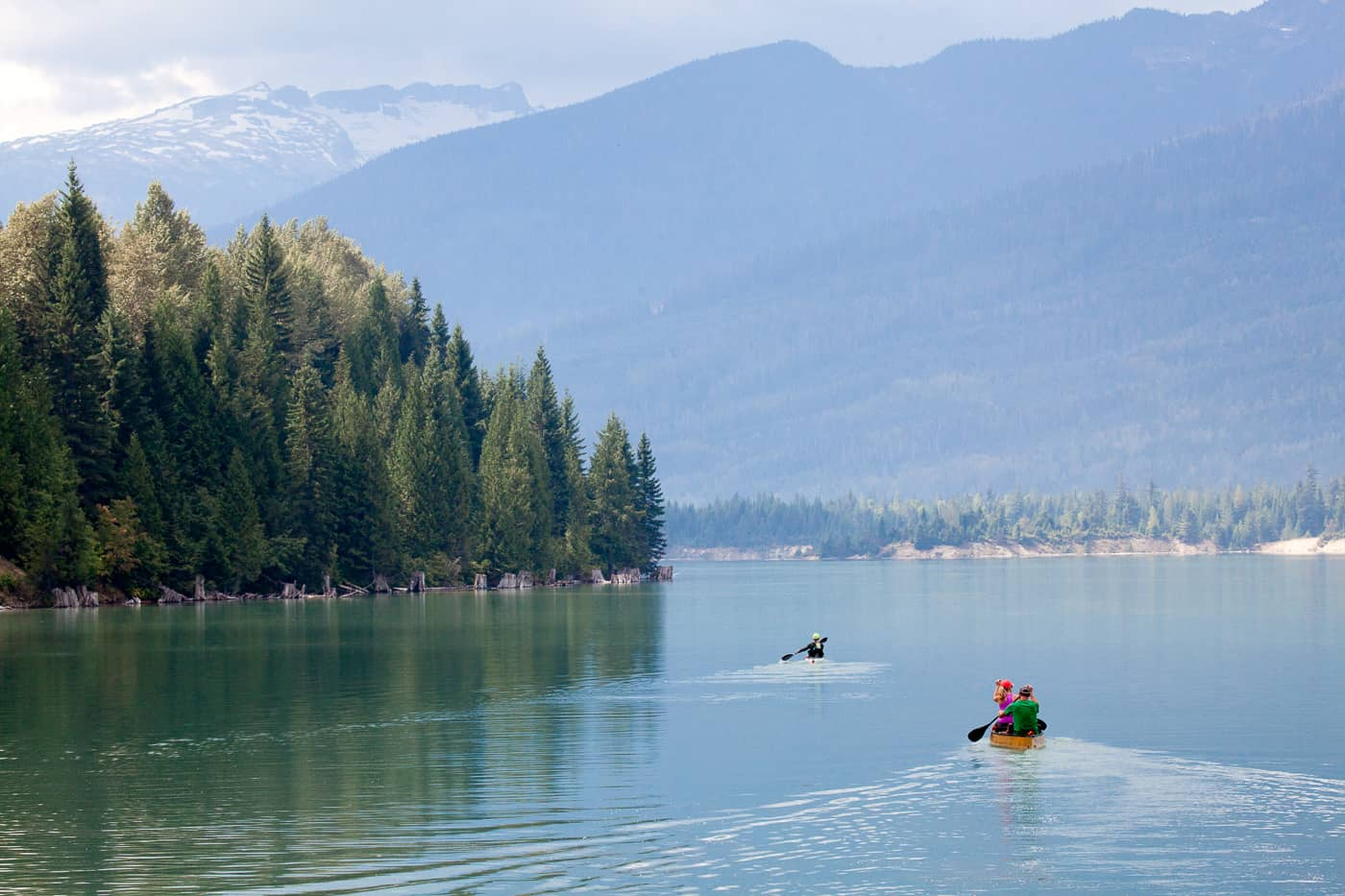 Canoeing on glassy Lake Revelstoke