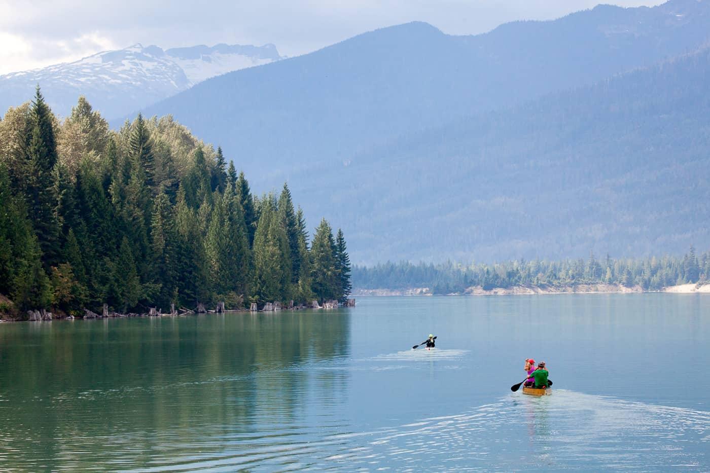 Canoeing on glassy Lake Revelstoke