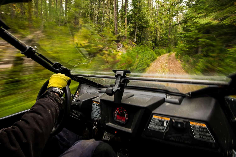 Driving an ATV off road in Revelstoke